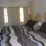 Bedrooms with 2 queen beds in each of the 2 bed 2 bath unit