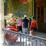  Tourists follow guide at Government Palace