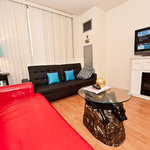 1 Bedroom Deluxe Suite - Living Room with 2 sofa beds, a Fireplace & a Plasma TV