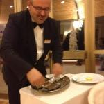  very Nice waiter preparing our dorade