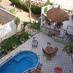 looking down from the roof terrace at Maison Abaka's pool and patio