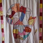  a quilted piece in the lobby of Maison Abaka
