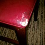 Worn seat in room