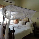 Our bed at Stone Town Cafe B&B