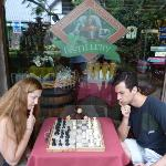 Exploring the chess board in front of the tasting shop