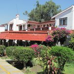  Garden and buildings of small family run hotel
