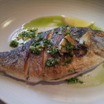 Superbly cooked bream with garlic, parsley and lemon sauce.