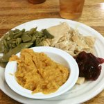 Turkey and dressing with cranberry sauce, pole beans and sweet potato suffle'
