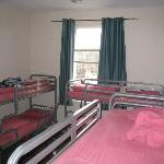 Another view of the room with 8 beds