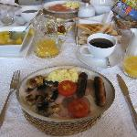 Full English breakfast, with fruits and toast and cereals