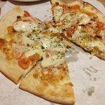 misty knoll white chicken pizza with red and yellow tomatoes