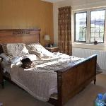  Kingsize bed and view out to front of house