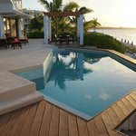 Villa pool with sunset