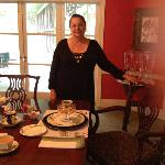 Owner Serving Breakfast in the Dining Room