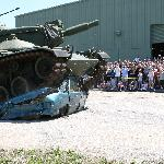 Car being crush by Tank during military extravaganza