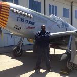  hubby posing with red tail plane