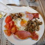 My breakfast- eggs, tomatoes, mushrooms, sausage, and ham.  Yummy
