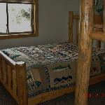 ONE OF THE BEDROOMS-QUEEN BED &amp; BUNK BEDS