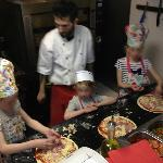 Our kids making pizzas