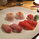 Scallop, yellowtail, and salmon nigiri sushi.