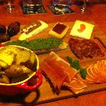 Cheese and meat plate with dates, potatoes, and crostini