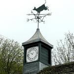 Cow weather vane on one of the yard buildings.
