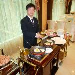 This young man made terrific omelets and cooked other dishes to order for breakfast.