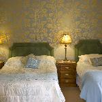 Room 3: Spacious, en-suite room offering twin or family accommodation. Nice views over the garde