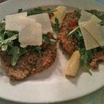 Straightforward veal medallions with arugula, tomato and shaved Parmigiano.