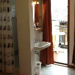 Room 1 shower, wash basin, balcony