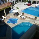  View from room entrance to pool area and reception