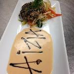 sesame crusted ahi tuna with lemon guava sauce and stir fry vegetables