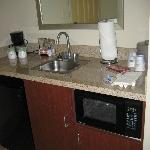 In room kitchenette, microwave, frig, coffee maker, sink.