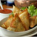 Our signature feta and coriander samosas with ginger jam