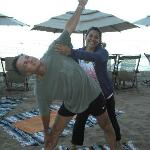 "Author of ""Buy A Million Dollars"" Greco Garcia in a beach yoga class with YV graduate Erika."