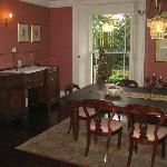  The elegant dining table where guests eat together around the mahogany table.