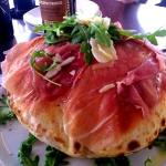 Pizza bread with prosciutto and arugula