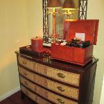 chest and coffee bar in room foyer