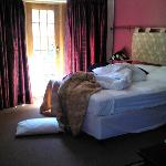 the big bed in the room that also has french doors that lead out into the garden