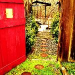 Walking into FireFly Cottage's private courtyard