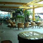 Hotel carpark smoking area, welcome waterfall, sitting area, courtesy bus