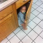 Child found in cabinet!  JUST KIDDING!  Don't call anyone, he wasn't really found there or left.