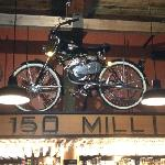 Great old bike in bar area.