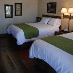  The Gold Rooms at the BackCountry Inn have two queen beds to accommodate up to four guests