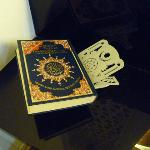  Al-Quran in the room. They also have praying mat.