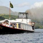 SY Gondola &quot;steaming&quot; on Coniston Water