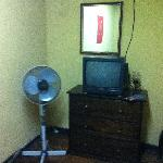 tv and fan in a twin room