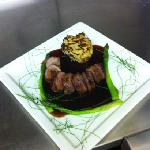 Duck breast ballotine with celeriac rosti, asparagus, port sauce & garlic chive