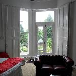 View of large French doors and shutters to enter room, having first walked up 4 stone steps