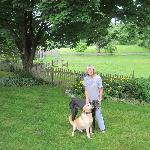 Owner Dorothy and her dogs in the back garden